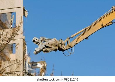 High reach demolition truck in action