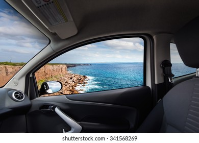 High red cliff viewed from inside a car
