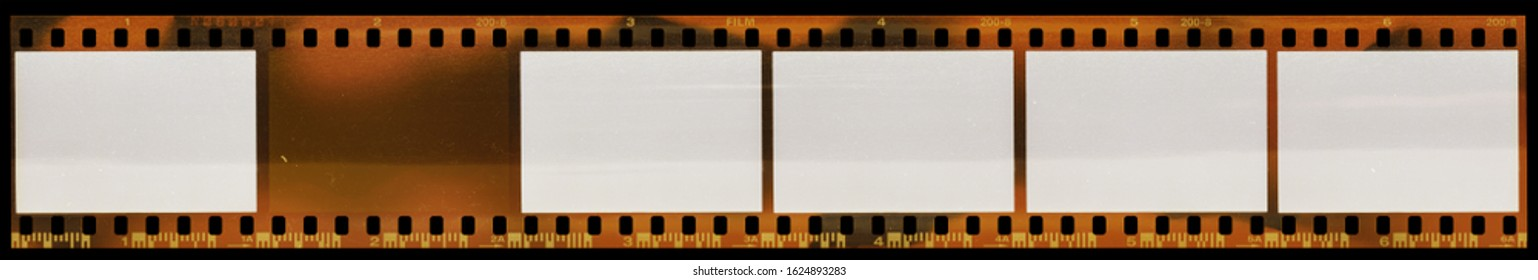 high res scan of 35mm negative filmstrip with empty or underexposed frames isolated on black background, add your content via blend mode, film material type 135.