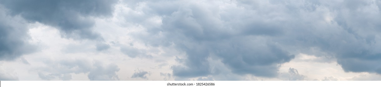 High resolution (54 megapixels) wide format photo of a dramatic overcast sky, with grey clouds. Taken in the afternoon. Freedom, storm, beauty of nature.