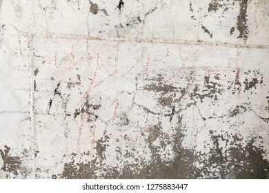 High resolution abstract textured wall words, numbers peeling paint industrial sandstone prison wall concrete abandoned historical