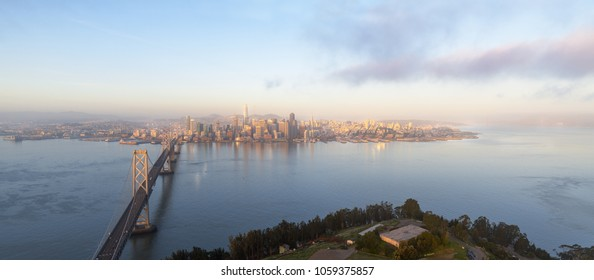 High Resolution Aerial Panorama of San Francisco's growing skyline at sunrise with Yerba Buena Island and the Bay Bridge in the foreground