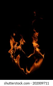 High resolution flame of fire in a burning heart isolated on black background