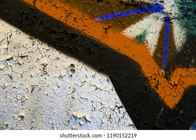 High resolution fragment of concrete wall with graffiti. Fluid smooth glowing saddle brown, grey and cobalt multicolor shapes.