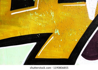 High resolution fragment of concrete wall with graffiti. Fluid smooth glowing olive, goldenrod and dark goldenrod multicolor shapes.
