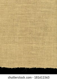 High resolution image of rough irregular weave burlap material with one ragged edge. Great background for that rugged look.