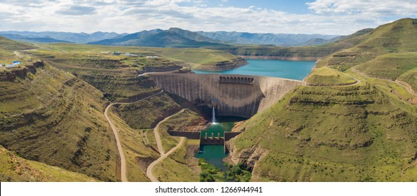 High resolution panorama of dam wall and surrounding landscape at Katse Dam in Lesotho during summer with a low water level on a clear sunny day