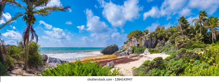 High resolution panoramic view of a beautiful beach and mayan ruins at the archeological site of Tulum in Mexico
