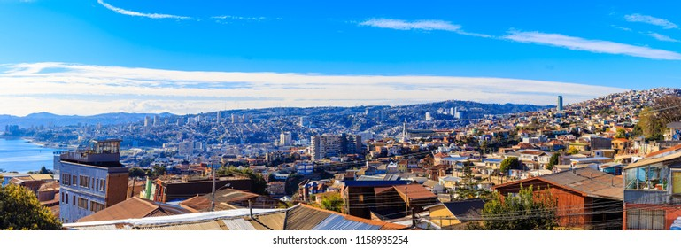 High resolution panoramic view of the city of Valparaiso with roofs, blue sea and clouds. Chile. July 18, 2018.