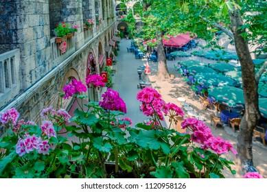 High resolution panoramic view of courtyard of historical Koza Han(Silk Bazaar) in Bursa,Turkey. - Shutterstock ID 1120958126