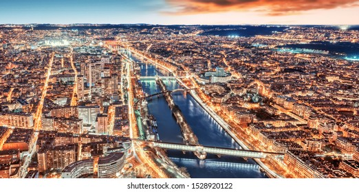 High resolution Paris city skyline rooftop view with River Seine at night, France. Sunset panorama.