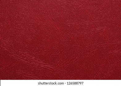 High resolution photo of red artificial leather.