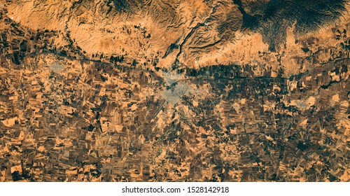 High resolution satellite image of  Kurdistan at the border between Syria and Turkey nearby Qamishli from above, aerial view, contains modified Copernicus Sentinel data [2019]