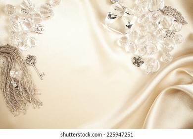 High resolution satin background. Crystals, diamonds and jewelry along with ornamental skeleton key.