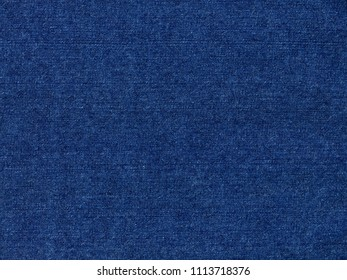 A high resolution scan of blue denim fabric. Ideal for use as a background texture