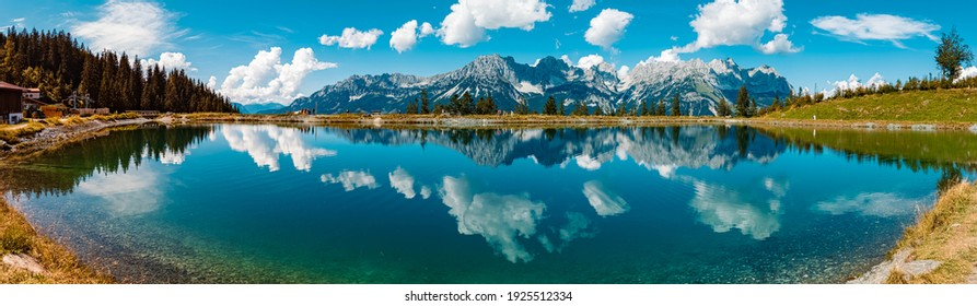 High resolution stitched panorama of a beautiful alpine summer view with reflections in a lake at the famous Astberg summit, Going, Wilder Kaiser, Tyrol, Austria