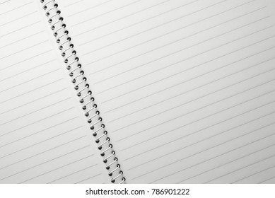 High resolution top view close up photo of opened notebook with copy space. Flash light made smooth and clear of  lined paper of notebook.