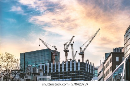 High rise building under construction in evening sky