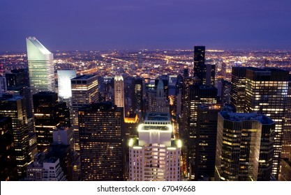 High rise buildings lighting up during sunset in New York City