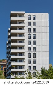 High Rise Condo Building with White Balconies