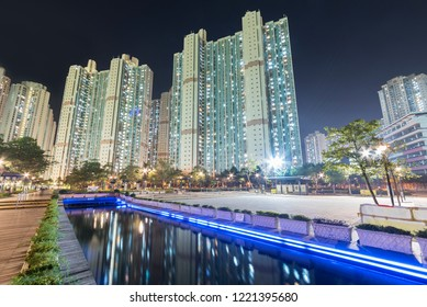 High rise residential building and public park in Hong Kong city at night