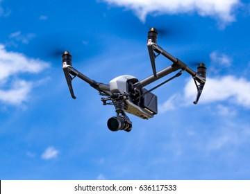 HIGH RIVER, AB - MAY 06 A professional drone films on a farm yard near High River