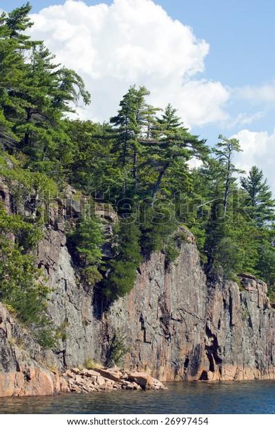 High rock cliff above Huron lake
