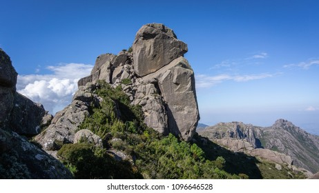 High rock mountain with clouds, blue sky and green nature in Brazil.