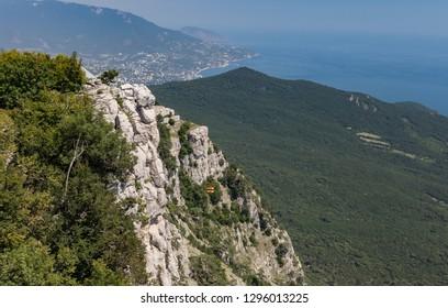 High rocks Ai-Petri of Crimean mountains. Black sea coast and blue sky. Russia.