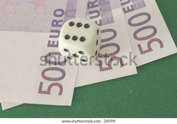 High roller: a die showing six on three high-value euro notes.