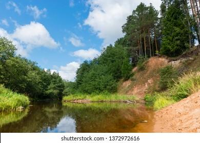 High sandy bank of the Polomet River, Novgorod Region, Russia