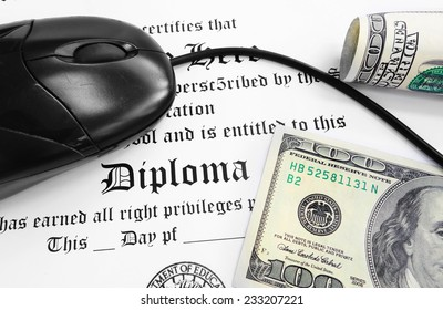 High school or college Diploma and mouse with cash