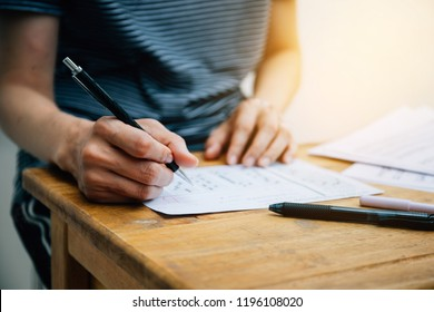 high school or college student writing in lecture class.examiner testing in examination room.concept for scholarship to study abroad.world international education learning,research for new knowledge