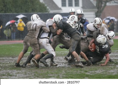 High school football game in the rain. Editorial use.