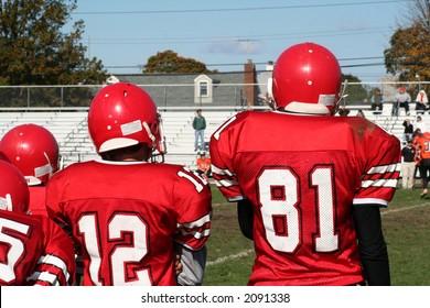 High School Football Team on Sidelines