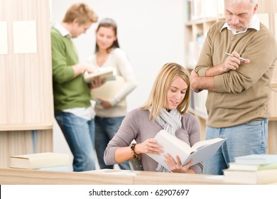 High school library - female student with mature professor read book
