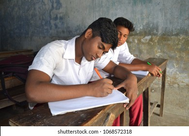high school student study in classroom sitting on the bench.