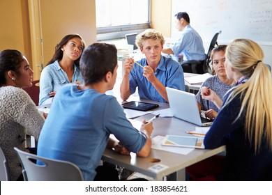 High School Students In Class Using Laptops