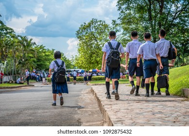 The high school students are going back home after school in Thailand, southeast Asia.