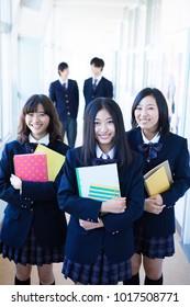 High school students standing in the corridor