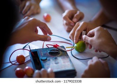 High school students are studying scientific experiment about electrochemistry in scientific laboratory, Thailand, southeast Asia.
