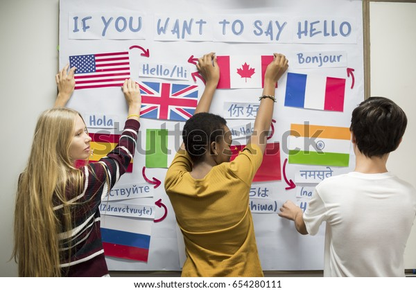 High school students working on international flags board