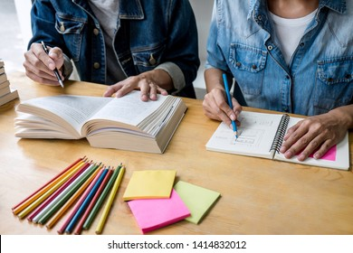 High school tutor or college student group sitting at desk in library studying and reading, doing homework and lesson practice preparing exam to entrance, education, teaching, learning concept.