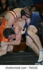 High school wrestlers competing. Editorial use only.