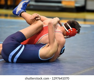 High School wrestlers competing at a wrestling meet.