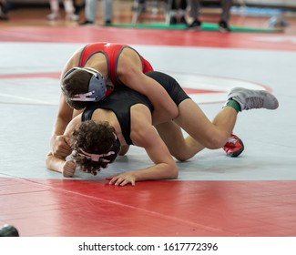 High School wrestlers competing at a wrestling meet