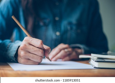 high school,college student writing in lecture class.examiner testing in examination room.concept for scholarship to study abroad.world international education learning,research for new knowledge