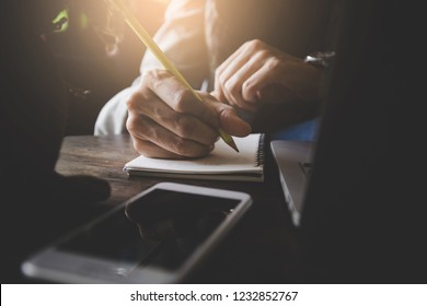 high school,college,university student use cell phone searching information from network.people writing notebook in modern library concept for scholarship to research international education learning
