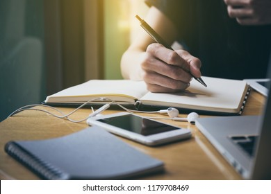 high school,college,university student using laptop searching information from network.people writing on notebook in modern library concept for scholarship to research international education learning