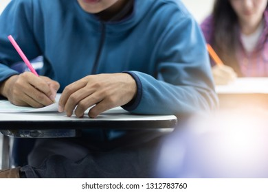 high school,college,university student writing in classroom or library at work space with book stack for knowledge prepare exams scholarship study abroad.research world international education learn